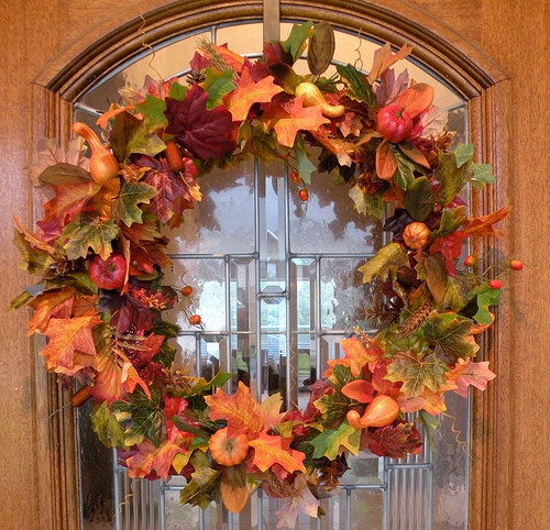 front-door-with-beautiful-fall-wreath-in-orange-colors