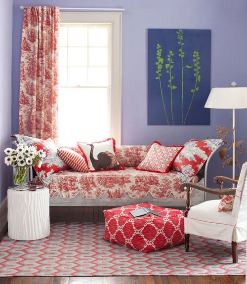 Red-Couch-in-The-Purple-Wall-Living-Room-with-Unique-White-Lamp-Table
